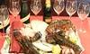 Menu di pesce con calice di vino