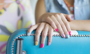 Unique Salon and Spa: Shellac Manicure and Regular Pedicure or Spa Mani-Pedi at Unique Salon and Spa (Up to 52% Off)