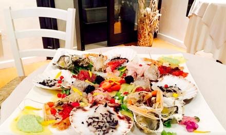 Menu Luxury Di Pesce Con 5 Portate E Bottiglia Di Vino Al Ristorante