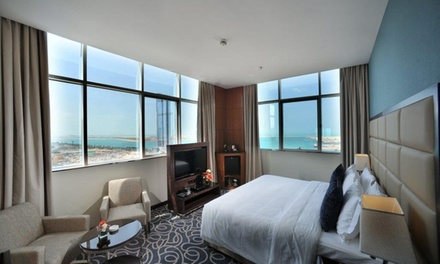 Abu Dhabi: 1 3 Nights in Deluxe Room for Two with Breakfast and Yas Theme Park Tickets at the 4* Ramada Abu Dhabi Corniche