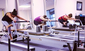 Body Chisel: Four Pilates Reformer Classes at Body Chisel (65% Off)