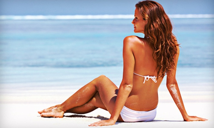 Daytona Beach Tanning Salon & Anti-Aging - Sandy Point: One Month of UV Tanning or Three Mystic Tans at Daytona Beach Tanning Salon & Anti-Aging (Up to 64% Off)