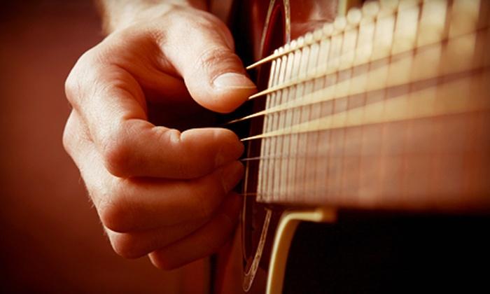 Mercury Guitar Studio - Grand Rapids: Eight or Four 30-Minute Private Guitar Lessons at Mercury Guitar Studio (Up to 57% Off)