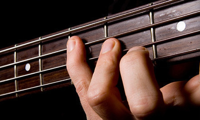 One Stop Guitar  - New Southside: $49 for Five Private Guitar Lessons at One Stop Guitar ($125 Value)