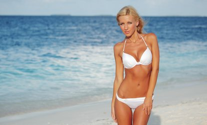 One or Three Spray Tans at Sun Kissed <strong>Tanning</strong> & Beauty (Up to 49% Off)