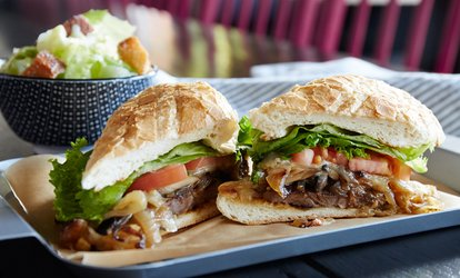 image for Cheesesteaks and Sandwiches at Delco's Original Steaks and Hoagies (Up to 47% Off). Three Options Available.
