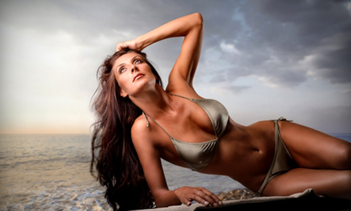 Midnite Sun & Cruise - Multiple Locations: $19 for Two Spray-Tanning Sessions at Midnite Sun & Cruise ($50 Value)