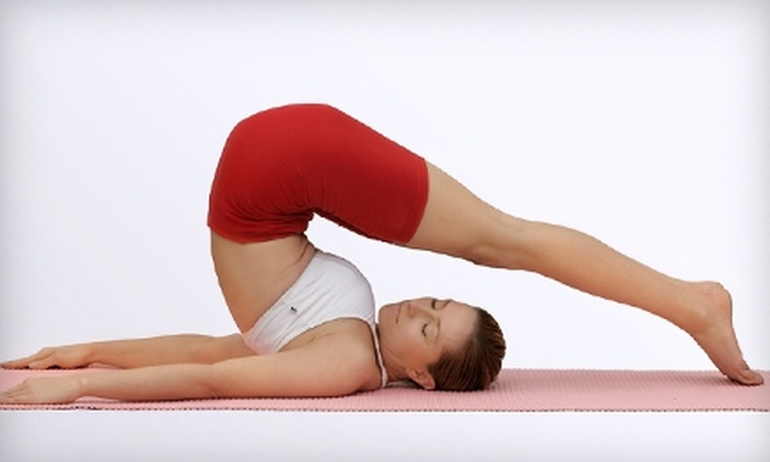 Bikram Yoga Mile High - Park Hill: $39 for One Month of Unlimited Classes ($149 Value) or $25 for Three Drop-In Classes ($51 Value) at Bikram Yoga Mile High