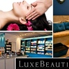 LuxeBeautiQue - Swampscott: $50 for Your Choice of Hot-Towel Massage, Facial, or Mani-Pedi at LuxeBeautiQue (Up to $115 Value)