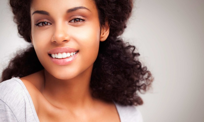 Whitening Xpressions - Located inside Studio Salons: One or Two 25- or 50-Minute Teeth-Whitening Sessions or Whitening Trays at Whitening Xpressions (Up to 85% Off)