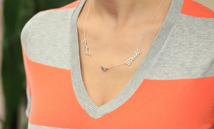 Couples Name Necklace from Monogram Online. Multiple Finishes Available from $39.99–$49.99.