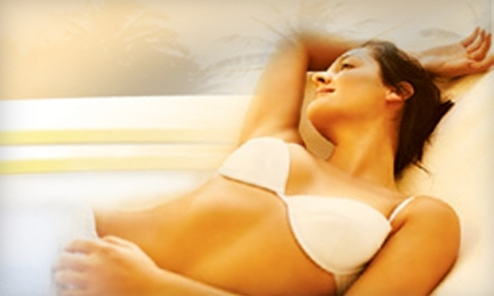 Executive Tans - Greenwood Village: $50 for $120 Worth of Tanning or Custom Airbrush Tanning at Executive Tans
