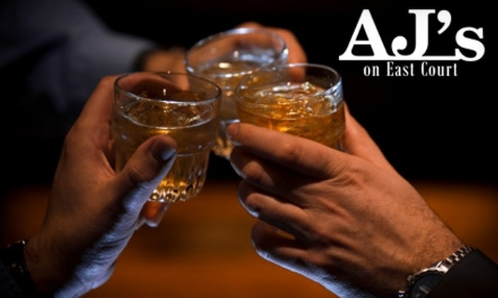 AJ's On East Court - East Village: $7 for $15 Worth of Drinks at AJ's on East Court
