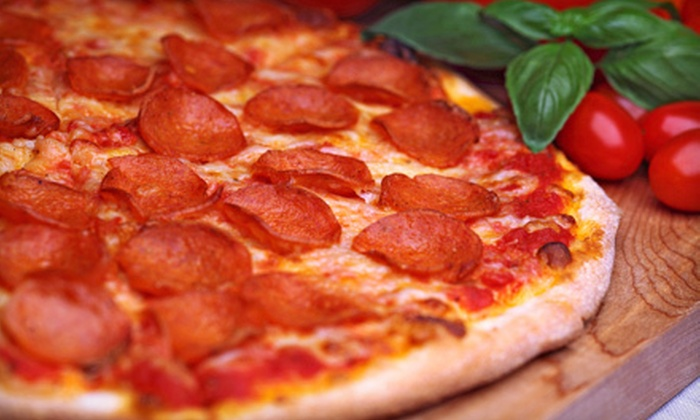 Ciago's - University: Pizza Dinner with Salads and Soft Drinks for Two or Four at Ciago's (Up to Half Off)