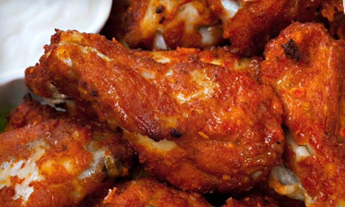 WingBusters USA - Multiple Locations: 25 or 100 Chicken Wings at WingBusters USA (Up to 53% Off)