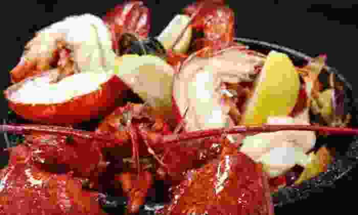 Stella's Fish Cafe - Uptown: Lobster Bake for Two with Salad, Dessert, and Bottle of Wine at Stella's Fish Cafe (Up to 53% Off). 3 Options Available.