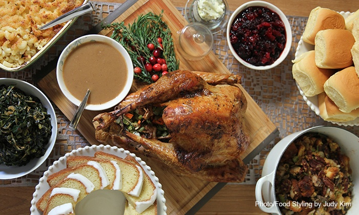Chef Carla Hall - Chelsea Market Baskets: Take-Home Thanksgiving Meal or Cookbook & Cookie Package from Chef Carla Hall (Up to 41% Off). Three Options.