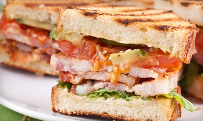 Moxie Bar & Grill - Northland: Sandwiches, Wraps, Burgers, or Barbecue for Two or Four with Bucket of Beers at Moxie Bar & Grill (Up to 52% Off)