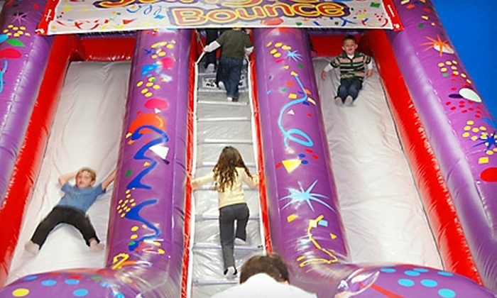 Jungle Bounce - Pappas Colony: $25 for 40 Arcade-Game Tokens, Two Open-Play Bounce Passes, One Large Pizza, and Four Sodas at Jungle Bounce in Holiday (Up to $49.99 Value)