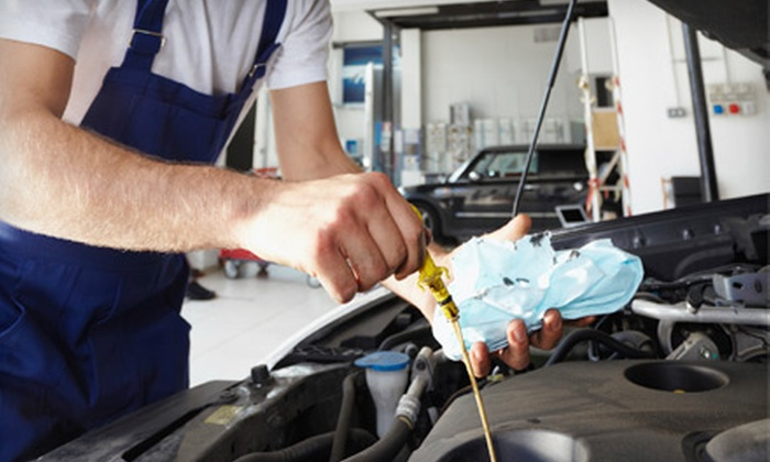 A A C Auto Clinic - Multiple Locations: Oil Change, Tire Rotation, and Set of Wiper Blades or Three Oil Changes at A A C Auto Clinic