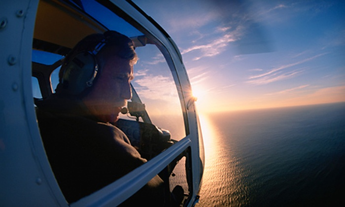 Palm Beach Helicopters - Atlantis: 15-Minute Helicopter Tour for Two or Four from Palm Beach Helicopters in Lantana