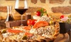 Mikalino's Pizza and Pasta - Victoria Estates: $12 for a 14-Inch Gourmet Pizza with Two Beers or House Wines at Mikalinos Pizza & Pasta in Turlock (Up to $25.95 Value)