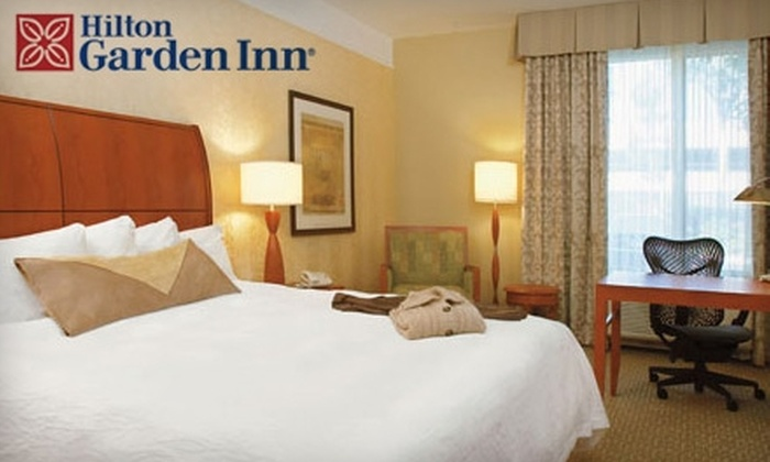 Hilton Garden Inn - Multiple Locations: One-Night Stay at the Hilton Garden Inn Plus Oregon Zoo Tickets or Golf at Charbonneau Golf Club. Choose Between Two Options.