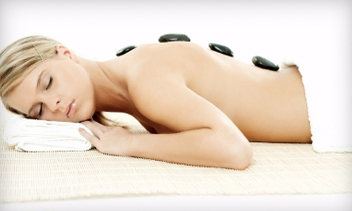 Unique Elegance Salon & Spa - Walker: $30 for a 45-Minute Hot Stone Massage at Unique Elegance Salon & Spa ($60 Value)