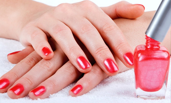 Symmetry Salon - Armour Hills: Shellac Gel Manicure or Spa Mani-Pedi at Symmetry Salon (Up to Half Off)