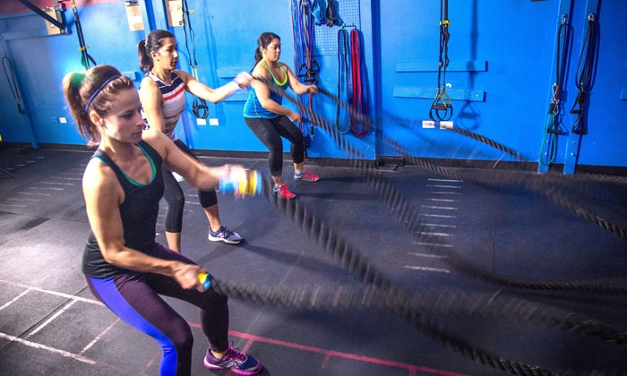 Hustle Fitness Corp - North Side: Four Weeks of Unlimited Small Group Personal Training Sessions at Hustle Fitness Corp (Up to 80% Off)