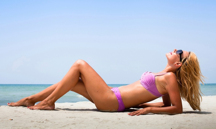 Sol Sunless Tanning - Flower Mound Location: Booth Spray Tan or Custom Airbrush Tan with Exfoliating Spray at Sol Sunless Tanning (Up to 70% Off)