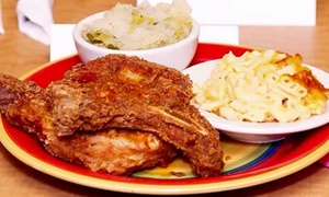 Pork Chops & Grits Cafe: Soul Food for Two or Four at Pork Chops & Grits Cafe (40% Off)