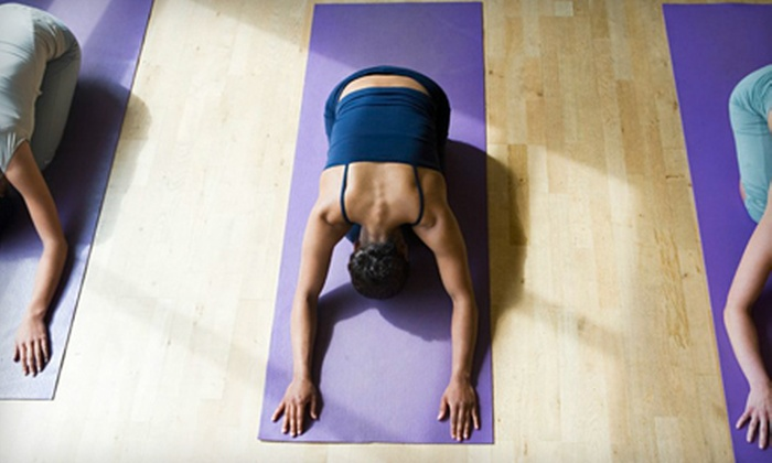 Bikram Yoga of Carle Place - Carle Place: $59 for 10 Bikram and Vinyasa Yoga Classes at Bikram Yoga of Carle Place (Up to $165 Value)