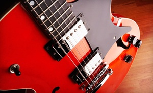 The Ultimate School of Guitar: $33 for Three Private Guitar or Piano Lessons or Two Vocal Lessons at The Ultimate School of Guitar (Up to $72 Value)