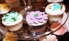 The Baking Grounds Bakery Cafe - Riverwalk: $10 for One Dozen Cupcakes or Petit Fours at The Baking Grounds Bakery Cafe in Suwanee ($21.88 Value)