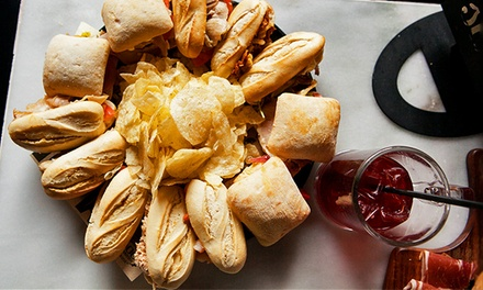 Sandwiches and Sangria at 100 Montaditos (Up to 50% Off). Three Options Available.