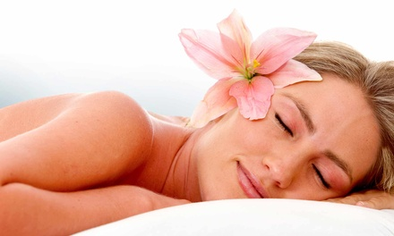 60- or 90-Minute Massage with Deluxe European Facial at Compliments at A Hilton Salon & Spa (Up to49% Off)