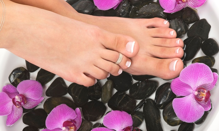 Rego Nail & Spa - Rego Park: One or Two Shellac Manicures and Regular Pedicures with Foot Massages at Rego Nail & Spa (Up to 55% Off)