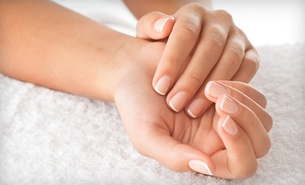 Regular or Gel Manicure and Pedicure at Nails by Lola at Rembrandt Spa (50% Off)