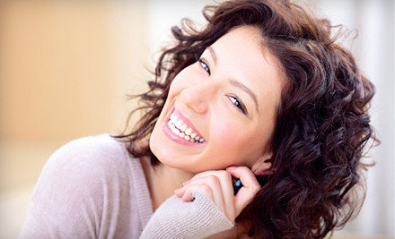 $49 for a Dental Exam, Cleaning, Fluoride Treatment, X-rays, and Cosmetic Consultation at Creative Smiles ($311 Value)
