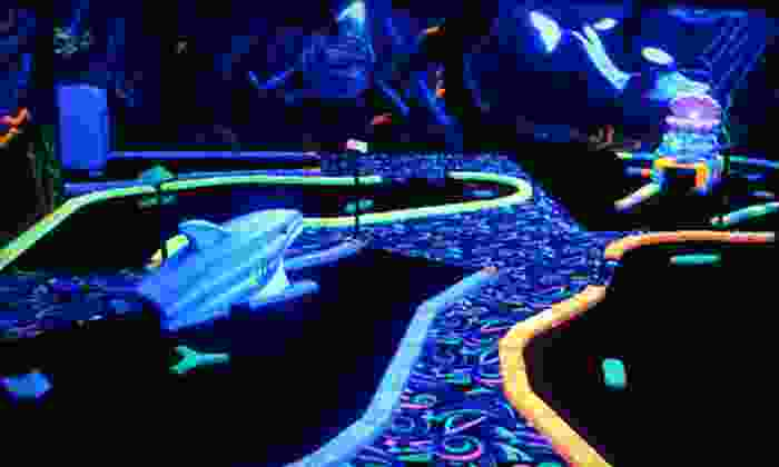 U-Puttz Black Light Miniature Golf - Weston Shops: 18 Holes of Glow-in-the-Dark Mini Golf for Four, Six, or Eight at U-Puttz Black Light Miniature Golf (Up to 58% Off)