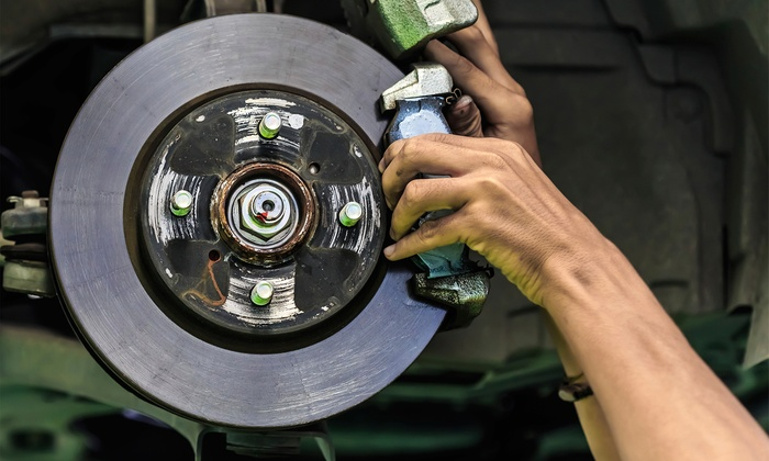H.T. Auto Service - Five Speed Auto: Brake Pad Replacement at H.T. Auto Service (Up to 50% Off), Two Options Available.