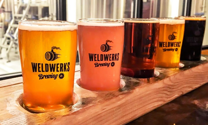 WeldWerks Brewing Company - Greeley: Brewery Experience with Flights and Take-Home Glasses for 2 or 4 at WeldWerks Brewing Company (Up to 43% Off)