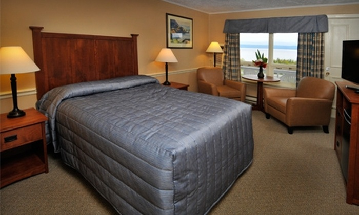 Silver Dart Lodge and MacNeil House Suites - Baddeck: One-Night Stay for Two. Two Options Available.