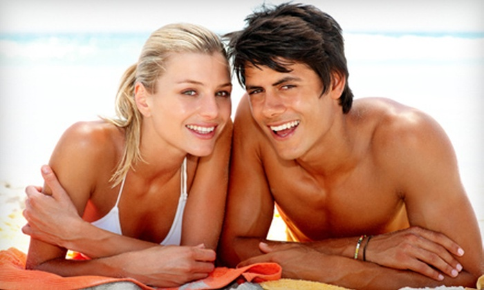Islands Tanning Med Spa - Multiple Locations: Three Spray Tans, One Month of Unlimited Tanning, or Both at Islands Tanning Med Spa (Up to 87% Off)
