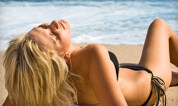 ProTan Spa - Multiple Locations: Spray Tanning and Red-Light Therapy at ProTan Spa. Three Options Available.