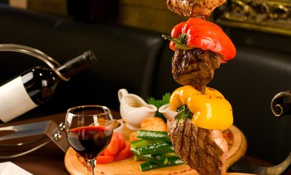 Full Rodizio and Bottles of House Wine for Two or Four at Cafe Mineiro <strong>Brazilian</strong> Steakhouse (Up to 41% Off)