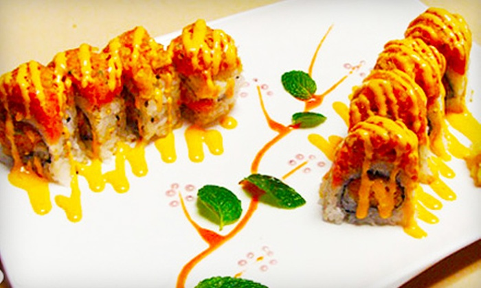 Akita Sushi Japanese Restaurant - Manhattan: $25 for Sushi, Sashimi, and Beer for Two at Akita Sushi Japanese Restaurant (Up to $58 Value)