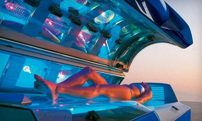 Ultra Glow Tanning Lounge - North Vancouver: $40 for One Month of Unlimited Tanning ($150 Value) or $49 for Three Spray Tans ($99 Value) at Ultra Glow Tanning Lounge in North Vancouver