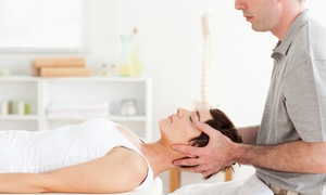 Lowry Chiropractic Health & Wellness: Chiropractic Exam Package or Three Hydro Massage Sessions at Lowry Chiropractic Health & Wellness (Up to 77% Off)